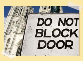"Image of a church with ""do not block door"" sign"