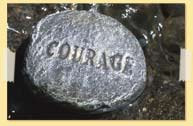 Image of Courage etched on a rock