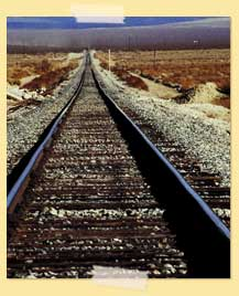 Image of railroad tracks in a desert-like area