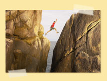 Man leaping between two rocks
