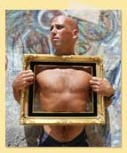 Image of a man holding a picture frame